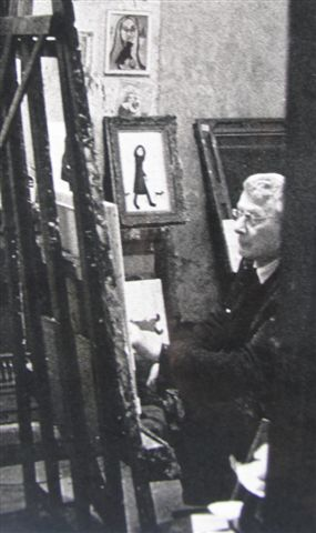 lowry-in-his-workroom-with-isherwoods-painting-of-woman-with-black-cat-on-the-wall-photo-courtesy-of-harold-riley.jpg